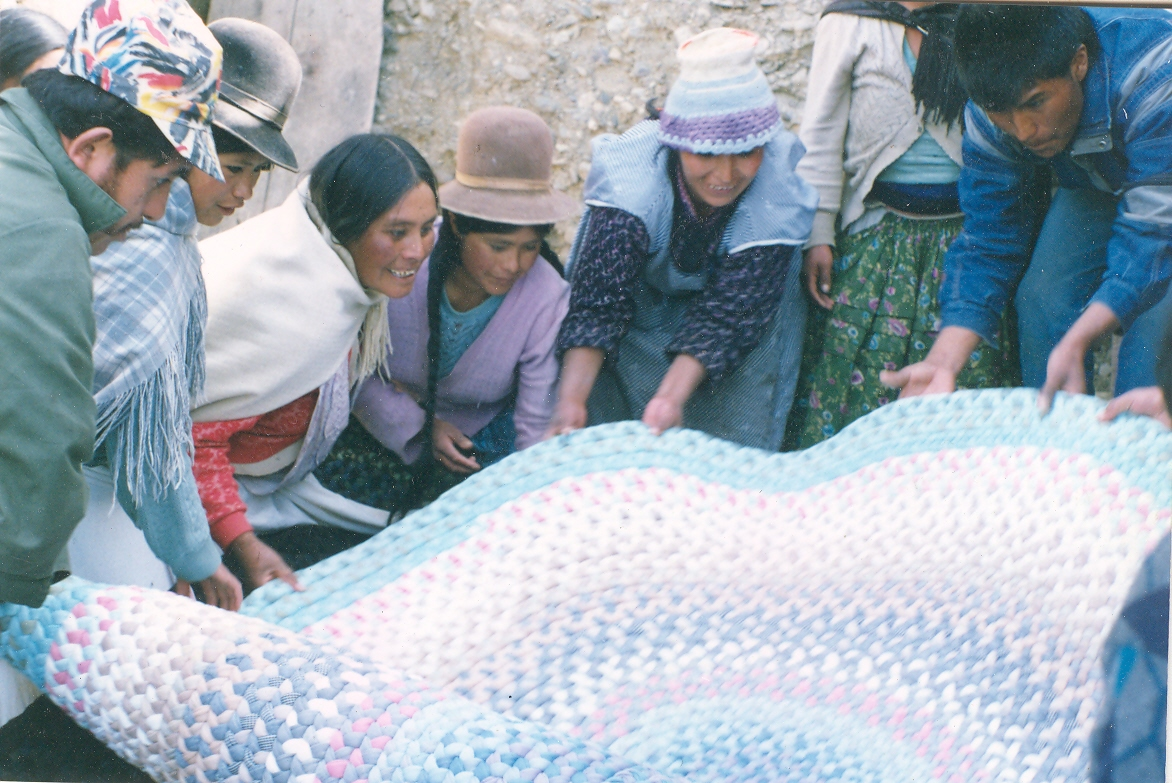 Bolivian cholitas admiring their work